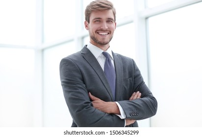 close up.serious young businessman standing in office.