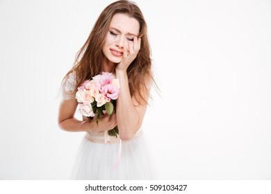 Close up upset bride. with bouquet