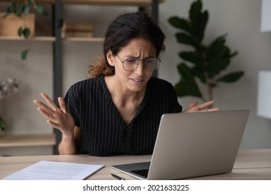 Close up upset businesswoman in glasses having problem with laptop, broken or discharged device, confused unhappy woman looking at computer screen, reading bad news, unexpected debt or spam