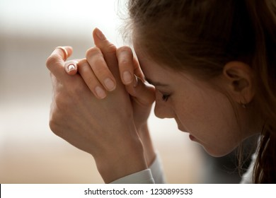Close up of upset woman feel down and sad having life or relationships trouble, frustrated female with eyes closed in despair think of problem solution, hurt girl heartbroken after breakup or bad news