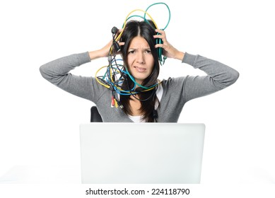 Close up Upset Woman in Gray Long Sleeve Shirt Putting Tangled Network Cables on Her Head While Experiencing No Internet Connection to her Laptop. Looking at the Camera. Isolated on White Background.