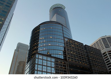 Close in upward view of downtown Minneapolis skyline with blue sky background