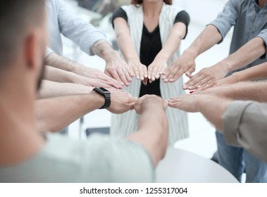 close up.young business team forming a circle of hands