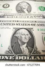 Close up of US dollar bank note with image of Jefferson and Washington. US money background.
