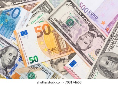 Close up of US dollar and euro banknote money. High resolution photo.