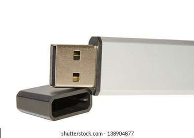 Close up USB flash drive memory or disk-on-key with cap cover isolated on white