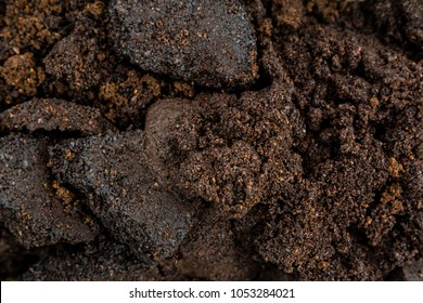 Close up of used coffee or garbage  as background, pattern, texture, design useful for concept.