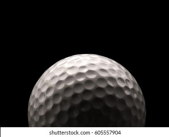 Close up of a used golf ball on a dark background