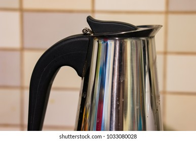 Close up of a used metal coffee cooker in soft focus