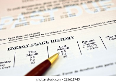 "Close up of a utility bill and ball pen showing a 60% energy usage increase over last month. In the background ""PAST DUE"" can be read in big white letters on faded red background."