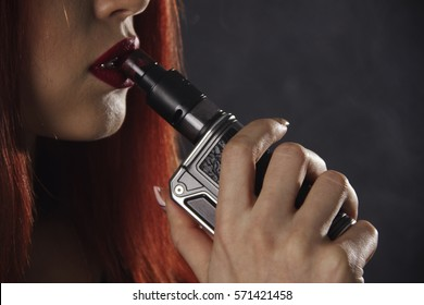 Close up of vaping young girl