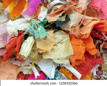 close up of variety of colorful pieces of fabric background