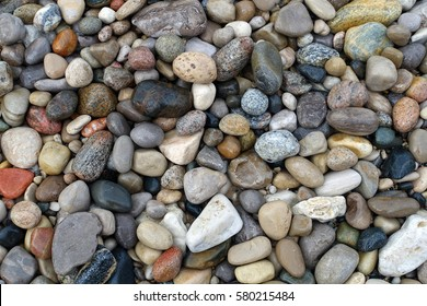 Close up of a variety of rocks found on a beach on Lake Michigan.
