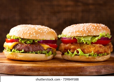 close up of various burgers on a wooden background