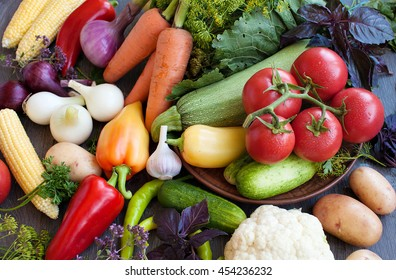 Close up of various colorful fresh raw vegetables. Flat lay. On black wooden table.