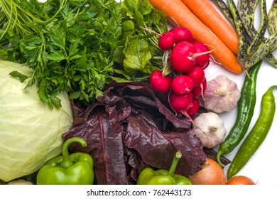 Close up of various colorful raw vegetables on white background.