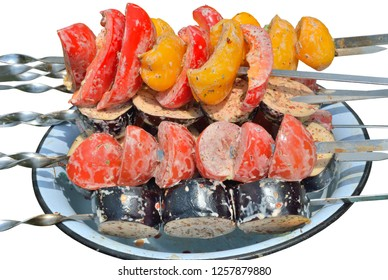 A close up of the vegetables on skewers. Isolated on white.
