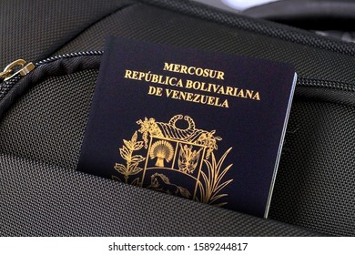 Close up of Venezuelan Passport in Black Suitcase Pocket