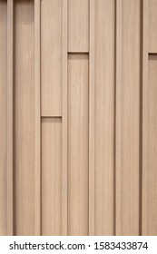 Close up vertically Texture of Large Brown decorative wooden battens wall pattern background.