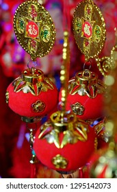 Close up of vibrant red ornaments for Tet at decoration shop on China town, Cho Lon, a market place to decor for Lunar New Year, Vietnam