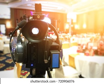 Close up of video canera at wedding and blurred background.