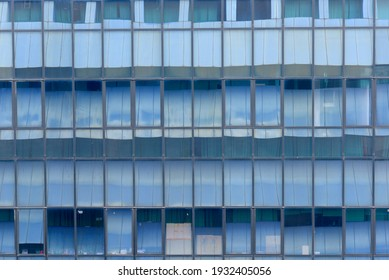 Close up view of an abstract building with window glass over blue sky background