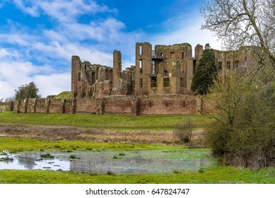 """A close up view across the meadow of the """"Great Mere"""", Kenilworth, UK towards the ruins of Kenilworth castle on a bright winters day"""