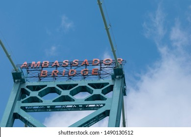 Close view of Ambassador Bridge - car / vehicle bridge connecting Windsor, Ontario, Canada and Detroit, Michigan, USA. Blue sky in the background, space for copy.