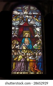 Close view of an ancient cathedral stained glass.