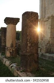 Close view of the ancient columns of famous Bagrati cathedral with the setting sun in Kutaisi, Georgia,July 2016