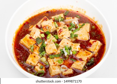 Close up View Asian traditional food Mapo doufu consists of tofu set in spicy sauce, typically a thin, oily, and bright red suspension, based on douban and douchi along with minced beef meat.