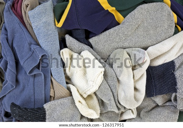 A close view of an assortment of men's laundered clothes.