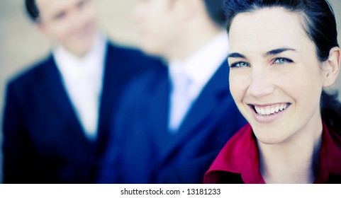 close view of attractive businesspeople smiling and talking