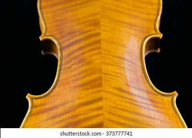 Close up view of the back of a violin.