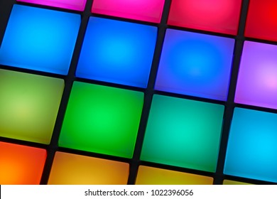 Close up view of backlit colorful buttons of a sound recording pad
