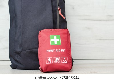 Close up view with a backpack along with a first aid kit ready for the mountain trip .