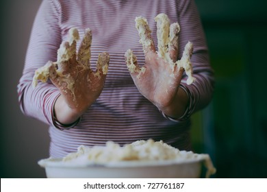 Close up view of baker kneading dough. Homemade bread. Hands preparing bread dough on wooden table. Preparing traditional homemade bread. Woman hands kneading fresh dough for making bread