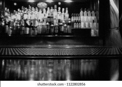 A close up view of a bar mat with a blurry background