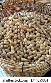 Close view of a basket of peanuts at the open air market