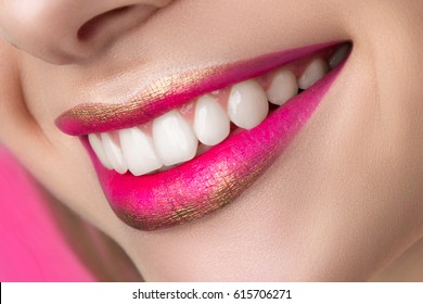 Close up view of beautiful smiling woman lips with fashion make up. Studio shot. Lips cosmetics, healthy skin and tooth, modern makeup or happy woman concept