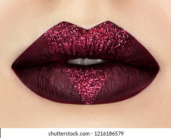 Close up view of beautiful woman lips with dark red lipstick. Fashion make up. Cosmetology, drugstore or fashion makeup concept. Studio shot
