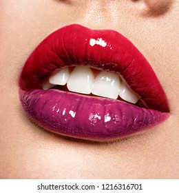 Close up view of beautiful woman lips with  gloss lipstick.. Open mouth with white teeth.  fashion makeup concept. Beauty studio shot. Gloss.