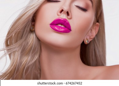 Close up view of Beautiful Woman Lips with Pink shiny Lipstick. Sexy big Lips. Beautiful Glitter Lip Makeup, Persistent Lip Gloss. Open mouth with white Teeth. Beauty Studio  Shot. Passionate Kiss