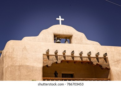 Close up view of the bell tower of a Spanish colonial church in New Mexico.