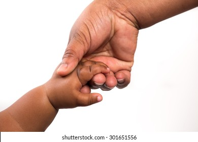 Close up view of a black / african woman holding a black / african baby's hand