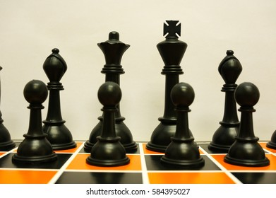Close up view of black chess pieces on chess board