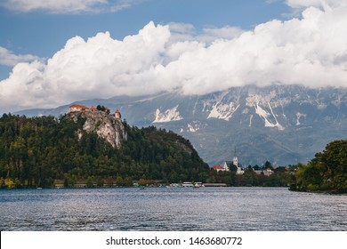 Close up view of the Bled Castle, the Bled city, St. Martin's Parish Church, parks and beaches situated on the bank of the Lake Bled, surrounded by forest and mountains. Travel concept.