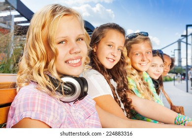 Close up view of blond girl and her friends