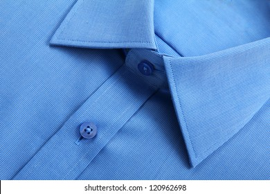 Close up view of blue business shirt.