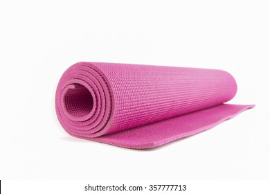 Close up view of blue open yoga mat for exercise, isolated on white background.